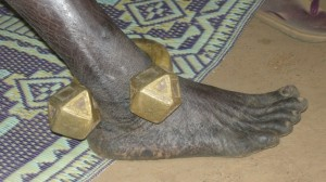 Heavy brass ankle bracelet forced to be worn by a Wahaya