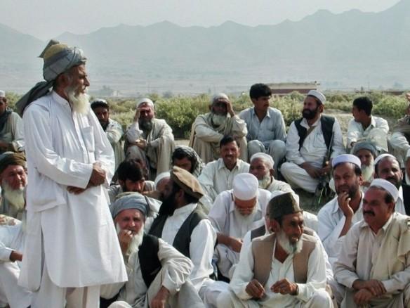 Old muslim men sit around deciding a girls future